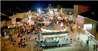 Aerial view of the rides and crowd at night at the 2011 Fall Festival