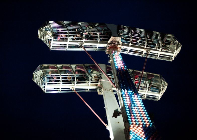People enjoying a ride at night at the 2011 Fall Festival
