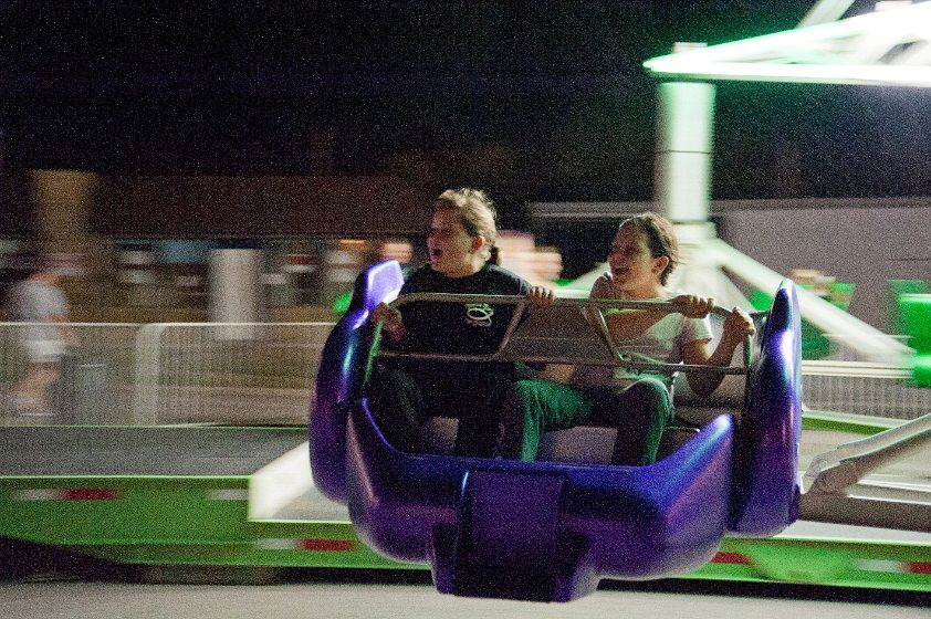 Two kids enjoying a ride at the 2012 Fall Festival 2