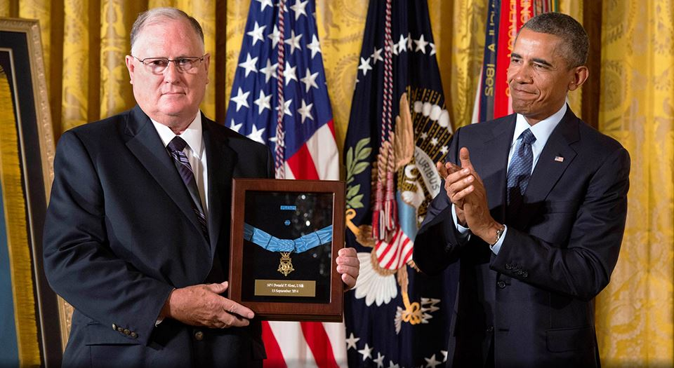 President Barack Obama and Dr. Bill Sloat with Donald P. Sloat's Framed Medal of Honor